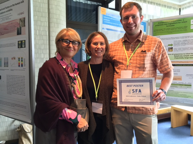 (L-R) Dr. Gonca Pasin and Dr. Maria Marco congratulate Dustin Heeney on his award for best poster at this year's annual ISAPP meeting in Turku, Finland in June.